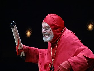 "Gilliam as Cardinal Fang in ""The Spanish Inquisition"" sketch during the Python reunion, Monty Python Live (Mostly), in 2014 Monty Python Live 02-07-14 12 47 50 (14415365418).jpg"