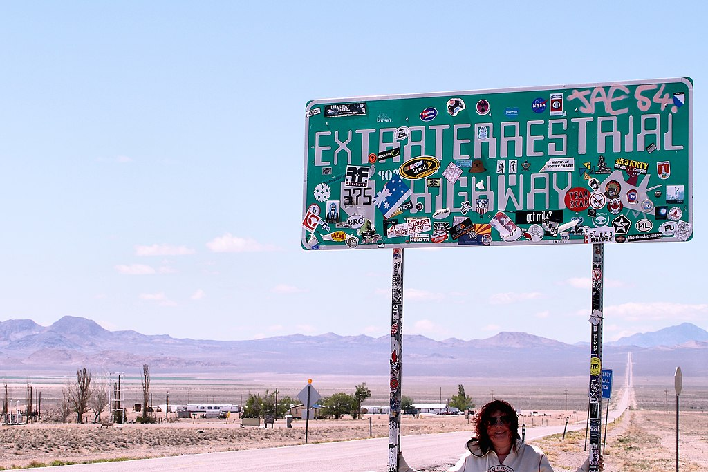 My gorgeous wife at the gateway to Area 51, Rachel in Nevada. Desolate, spooky and extremely cool -) (14033800198).jpg