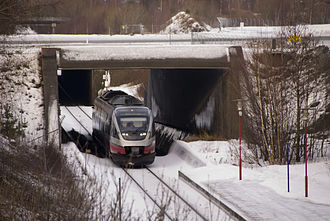 Hell–Sunnan Line - Class 93 train passing through the Værnes Tunnel under Trondheim Airport, Værnes' taxiway