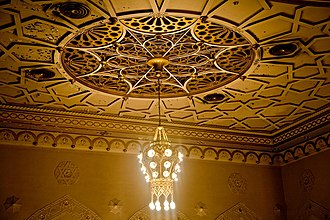 New York City Center - Detail of the ceiling with one of the lights and arabesque motifs