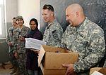 National Guardsmen distribute school supplies DVIDS342606.jpg