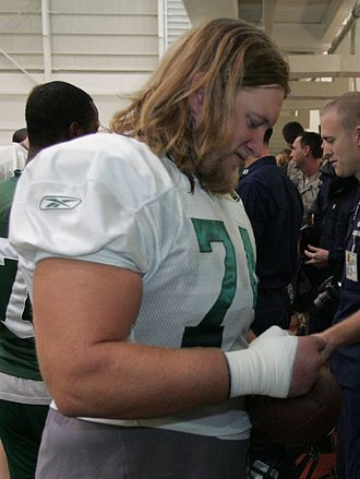 Nick Mangold - Mangold signing autographs at Jets 2009 training camp.