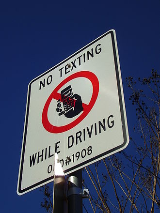 Texting while driving - A sign in West University Place, Texas (Greater Houston) advising drivers that they are not allowed to text
