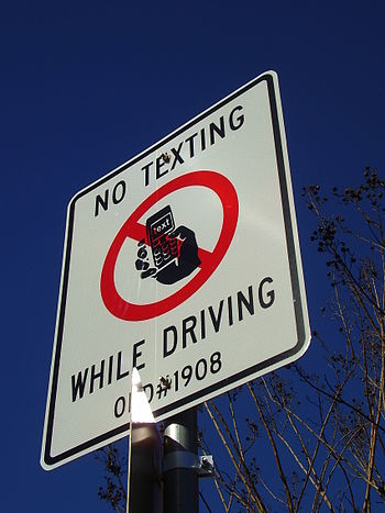 "English: A sign that states ""No Texting W..."