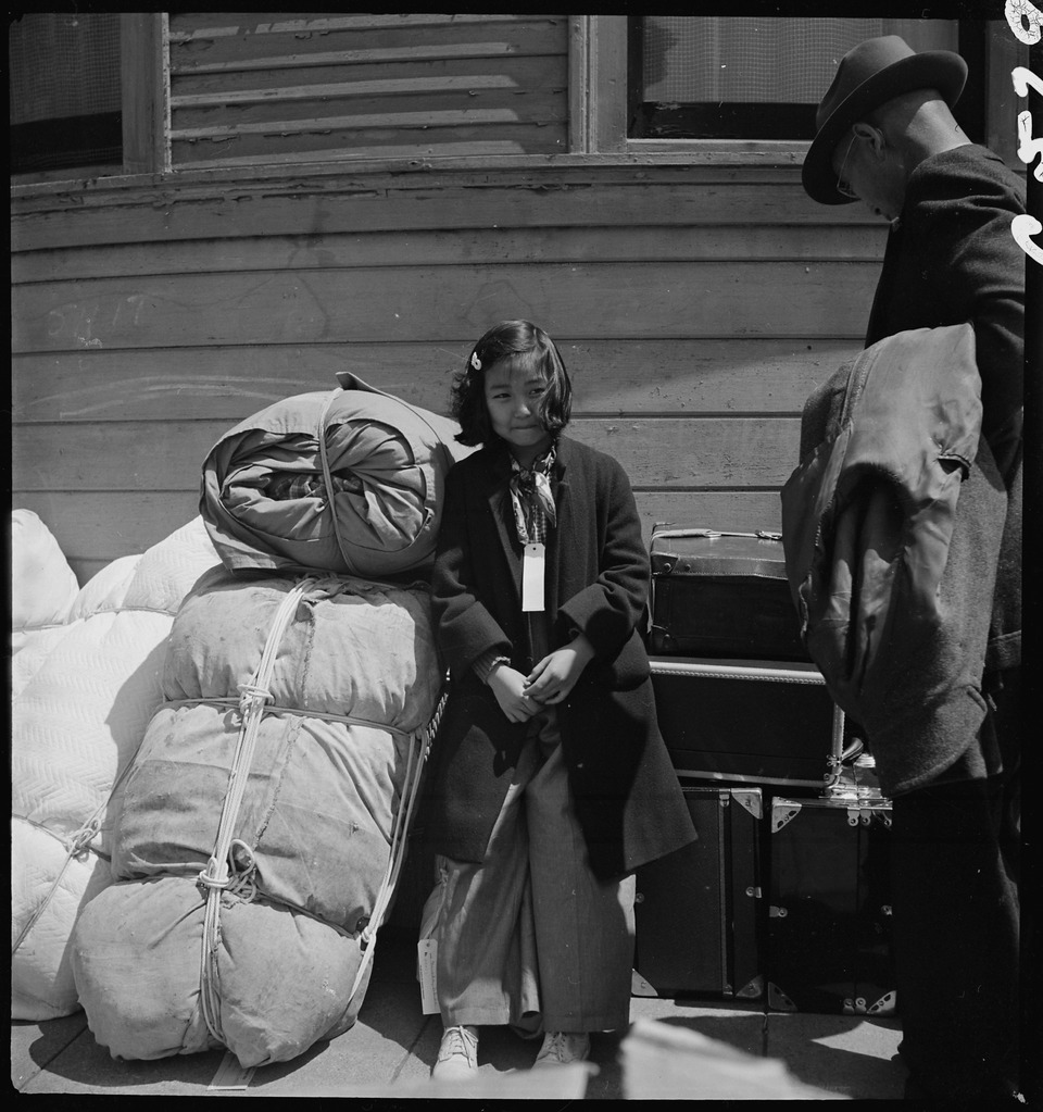 http://upload.wikimedia.org/wikipedia/commons/thumb/a/af/Oakland%2C_California._Young_evacuee_of_Japanese_ancestry_guarding_the_family_belongings_near_the_War_._._._-_NARA_-_537889.tif/lossy-page1-960px-Oakland%2C_California._Young_evacuee_of_Japanese_ancestry_guarding_the_family_belongings_near_the_War_._._._-_NARA_-_537889.tif.jpg