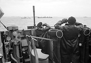 Anti-submarine warfare - Royal Navy officers on the bridge of a destroyer on convoy escort duties keep a sharp look out for enemy submarines during the Battle of the Atlantic, October 1941
