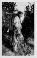 Ojibwe woman with baby in tiginaagan.png