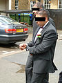 Oxford sham marriage - Groom is led away in handcuffs2.jpg