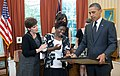 P062011PS-0478-Lois-Curtis-Barack-Obama-Oval-Office-20-Jun-2011.jpg