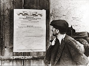 Polish Committee of National Liberation - A propaganda photo of a citizen reading the PKWN Manifesto, the real date and place unknown
