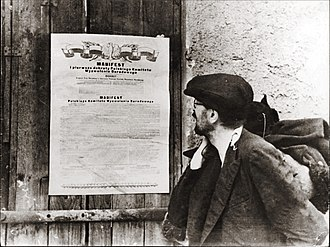 Eastern Bloc politics - A propaganda photo of a citizen reading the Polish Communist party PKWN Manifesto, edited by Joseph Stalin, posted after the initial 1944 Soviet occupation of Poland in World War II before it was transformed into the People's Republic of Poland.