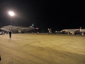 Faisalabad International Airport - PIA A310 and Flydubai Boeing 737 being prepared for international flights.