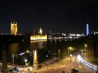 Parliament of the United Kingdom - Parliament at night, with the London Eye visible on the right
