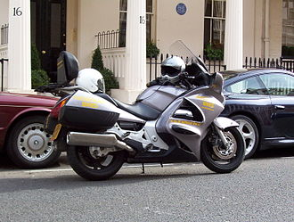 Motorcycle taxi - A motorcycle taxi waiting for passenger in London