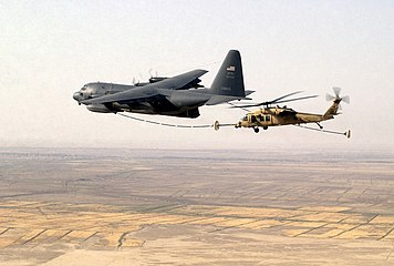 Pave Hawk refueled by HC-130 Hercules over Tallil Air Base Iraq