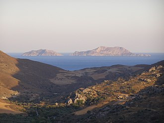 Paximadia - The Paximadia in the distance with the monastery of Preveli in the foreground.