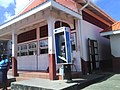 Pay phone outside the fish market in Sauteurs, Grenada (2009).jpg