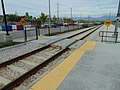 Pedestrian level crossing at 4800 W Old Bingham Hwy station, Apr 15.jpg