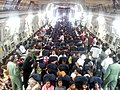 People evacuated from Yemen seated in an IAF C-17 Globemaster-III aircraft at Djibouti prior to taking off to Mumbai, evacuated by the Indian Air Force (IAF), on April 05, 2015.jpg