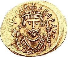 A gold coin with the bust of Phocas. His eyes form the central focus of the image