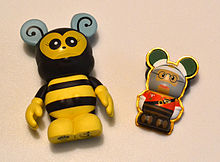 Photo Illustrating A Disney Vinylmation Figure And 3D Pin