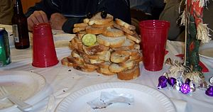 "Beefsteak (banquet) - Two diners' bread piled to ""keep count"" at a beefsteak"