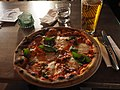 Pizza Nduja and beer at restaurant Broo.jpg