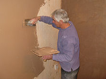 Beautiful A Plasterer Covering A Wall, Using A Hawk (in His Left Hand) And Trowel (in  His Right Hand)