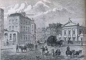 Black-and-white engraving showing London buildings in the background and carriages and people in the foreground.