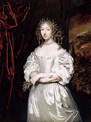1650–1700 in Western European fashion - Susanna Huygens wore a long, tight white satin bodice with paned sleeves lined in pink and a matching petticoat. Her hair is worn in a mass of tight curls, and she wears pearl eardrops and a pearl necklace. 1667–69.