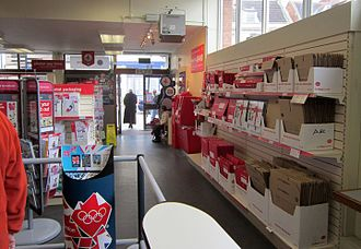 Post Office Ltd - Interior of a post office, showing available merchandise