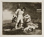A blindfolded prisoner is tied to a stake, about to be shot by a firing squad. Another man lies dead nearby. In the distance, several prisoners are blindfolded and tied to stakes; they have all been shot and killed by firing squads.
