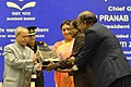 Pranab Mukherjee gave away the Saakshar Bharat awards, at the International Literacy Day celebrations, in New Delhi on September 08, 2015. The Union Minister for Human Resource Development, Smt. Smriti Irani is also seen (1).jpg