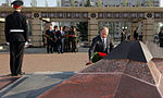 Prime Minister Vladimir Putin laying flowers at the Eternal Flame under the Colonnade of the Memorial to Glory in Kazan.jpeg