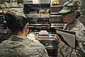 Public health technician from 177th MDG conducts food-safety inspections on Spangdahlem Air Base 150804-Z-IM486-031.jpg