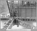 Queensland State Archives 4027 Erection of last cross girder centre of suspended span Brisbane 25 October 1939.png