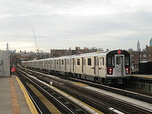 7 (New York City Subway service) - A train made up of R188 cars in 7 local service leaving 52nd Street, bound for Manhattan.