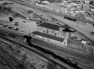 Readville (MBTA station) - 1977 aerial view of the former two-story depot, which burned in 1983, from the west
