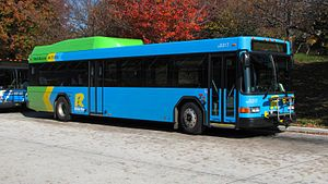 Ride On (bus) - A Gillig diesel-electric hybrid bus at Glenmont station, in the most recent paint scheme