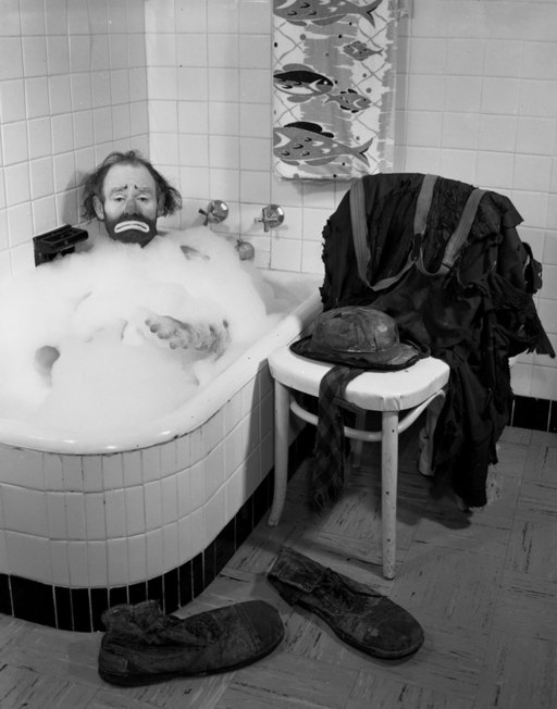 Ringling Circus clown Emmett Kelly in a bubble bath Sarasota, Florida