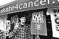 Rob Dyer in front of a Skate 4 Cancer booth.jpg