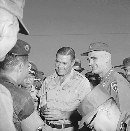 Secretary of Defense Robert McNamara and General Westmoreland talk with General Tee on conditions of the war in Vietnam. Robert S. McNamara and General Westmoreland in Vietnam 1965.png