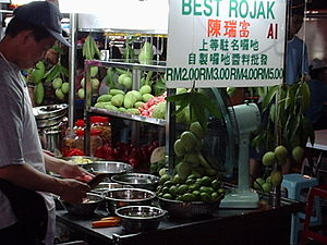 Penang cuisine - A hawker stall selling rojak, a fruit dish in shrimp and chilli paste