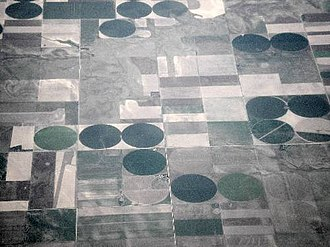 Farm - Farmland in the United States. The round fields are due to the use of center pivot irrigation