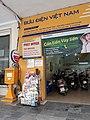 Sạp báo cạnh Bưu điện Hà Nội (A newspaper kiosk beside Hanoi Post Office, Vietnam).jpg
