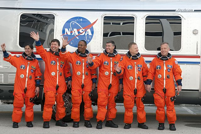 Crew of Shuttle Discovery in orange ACES suits