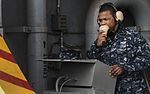 Sailor communicates aboard ship 121210-N-KE148-273.jpg
