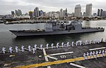 Sailors and Marines man the rails and render proper honors as USS Boxer passes USS Bunker Hill (29573137191).jpg