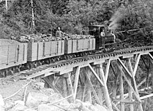 Narrow gauge coal train on a trestle bridge