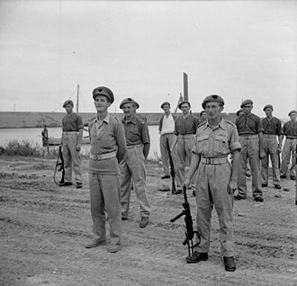 History of the Special Air Service - Members of 2nd SAS on parade for an inspection by General Bernard Montgomery, following the successful capture of the port of Termoli. On the left is Major E Scratchley DSO, MC, and on the right is Captain Roy Farran holding a German sub-machine-gun